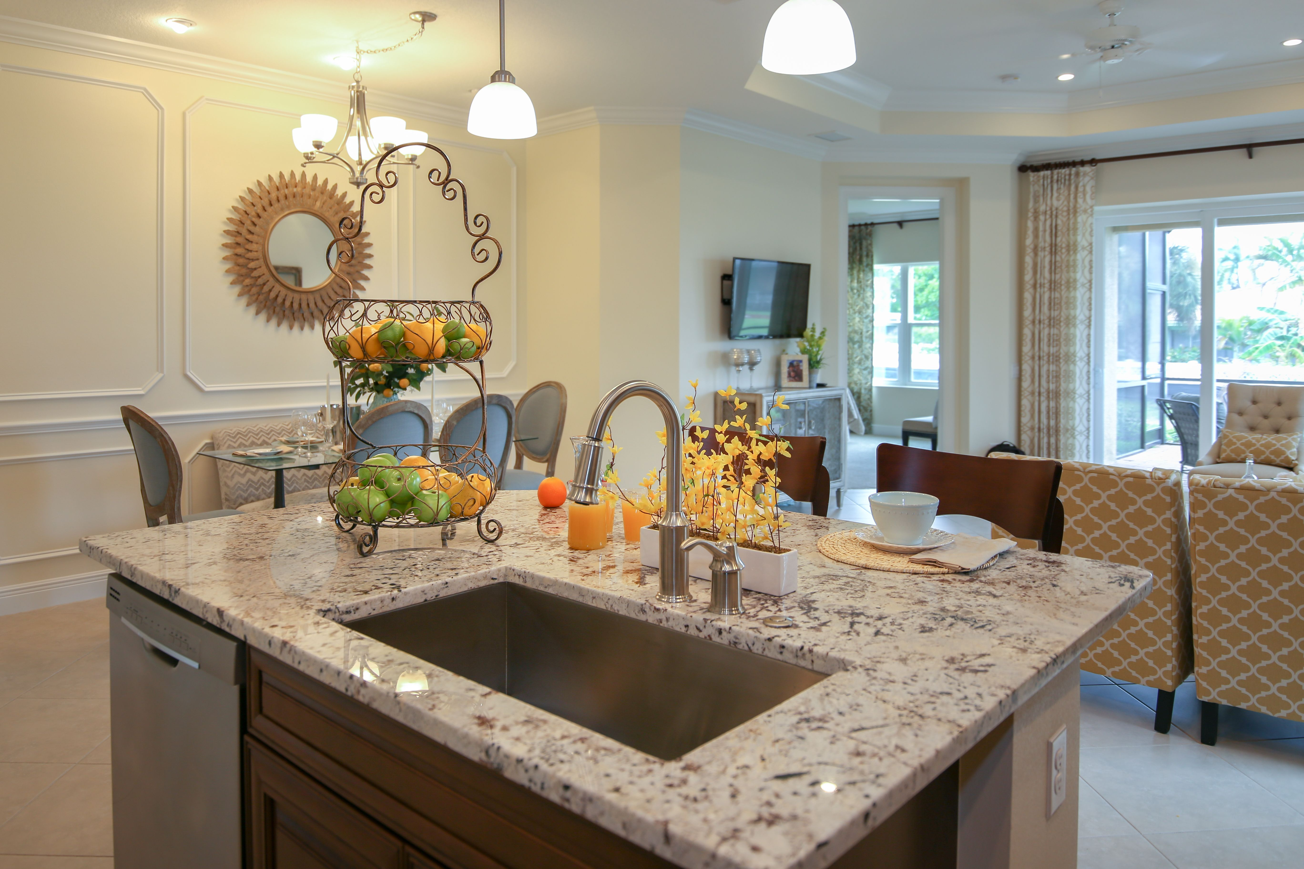 Kitchen with island counter and breakfast nook.