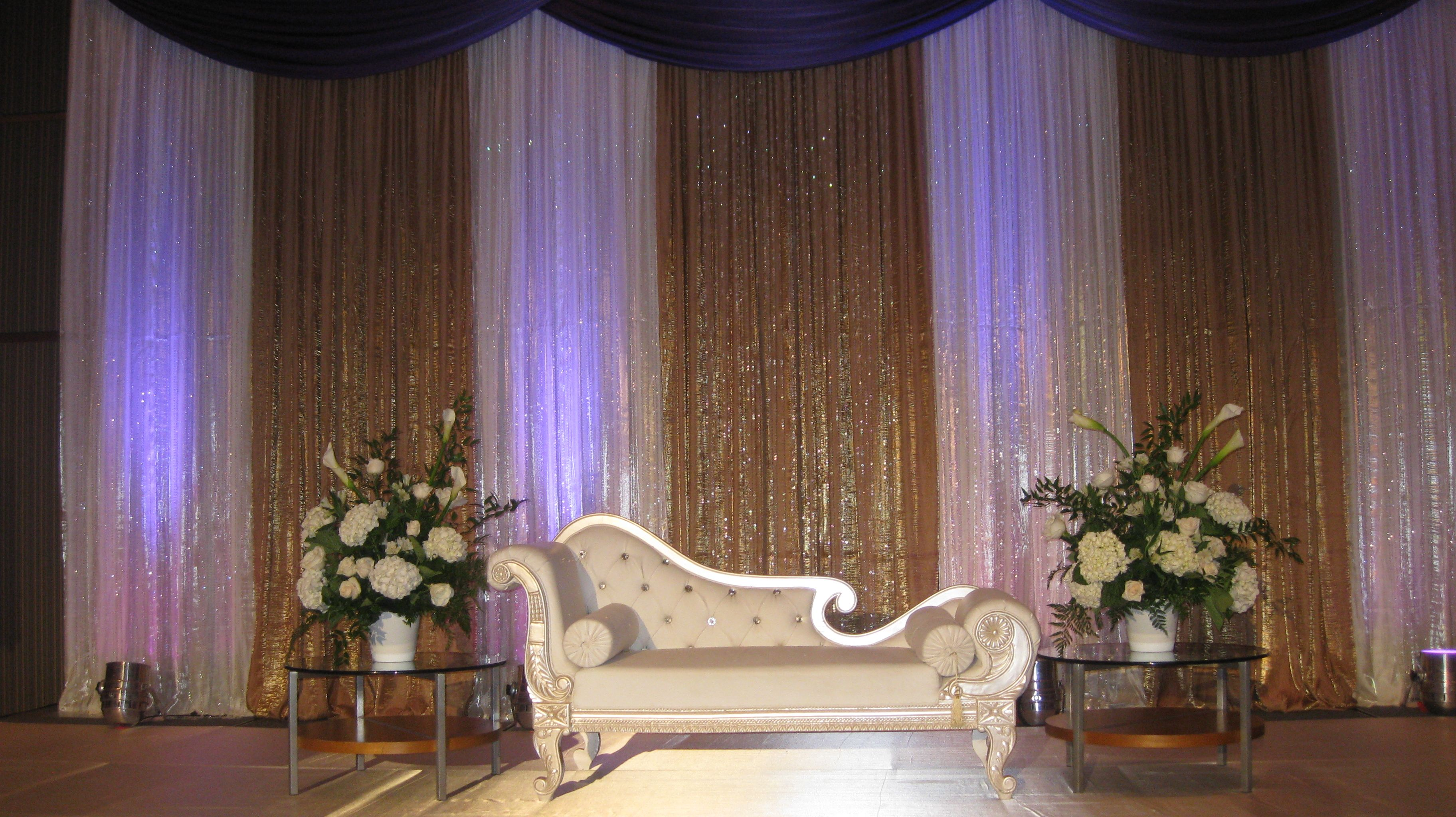 ivory and gold tissue satin fabric for the backdrop with a