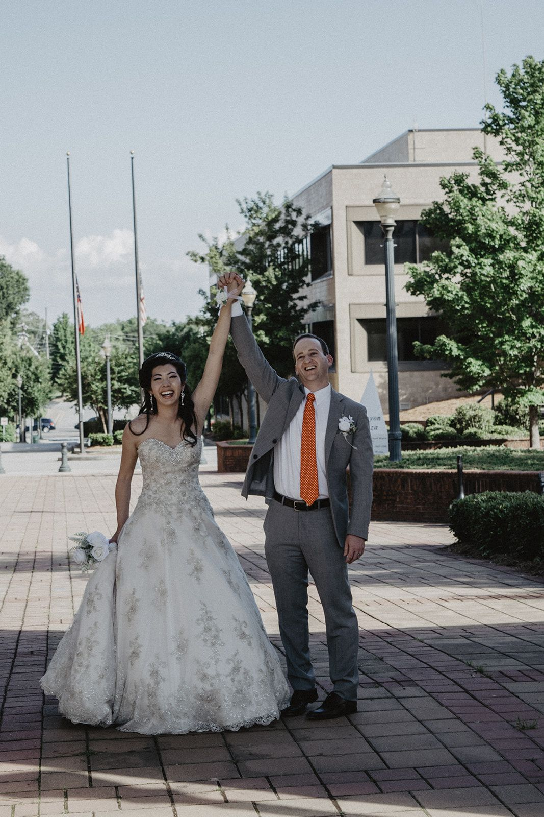 Bride and groom celebrating after their courthouse ceremony