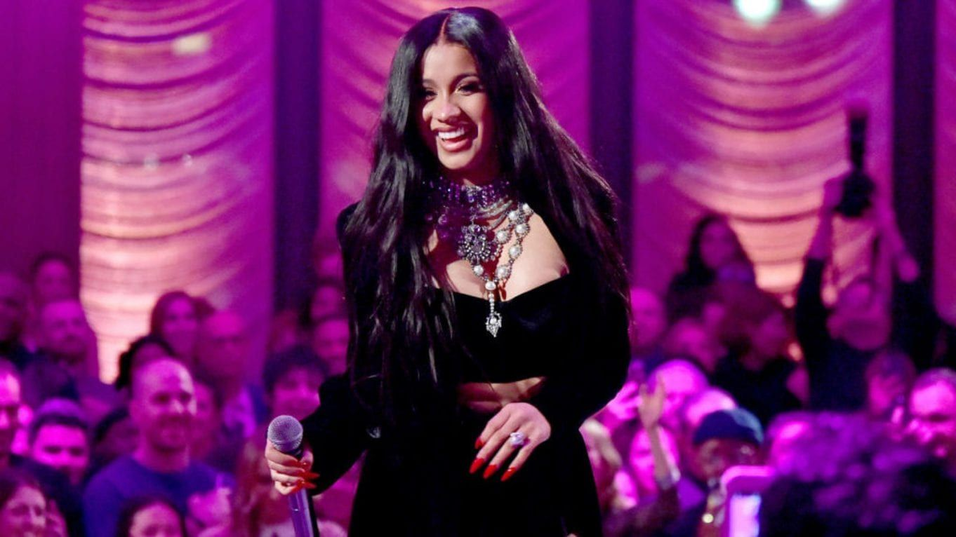 Cardi B Debuts Colorful New Butterfly Back Tattoo: The Grapevine Cardi B Becomes 1st Woman To Headline