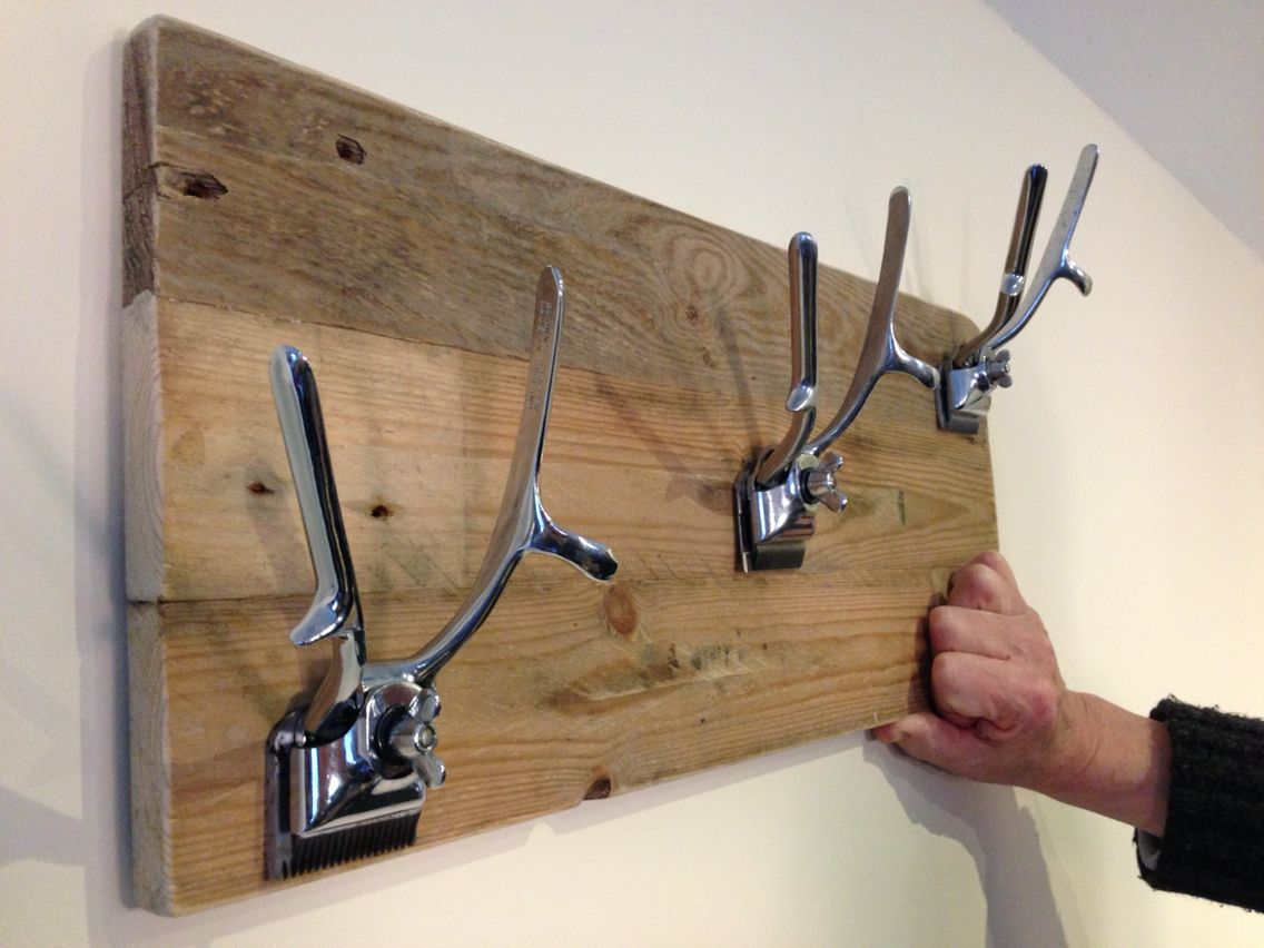 Up Cycled Barbering Clippers used to make coat hangers / coat rack. Barber  shop furnishing