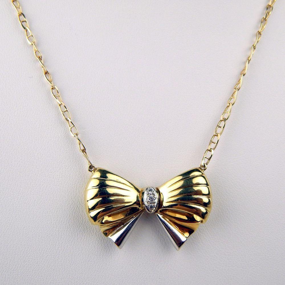 Diamond bow motif pendant necklace kt white u yellow gold