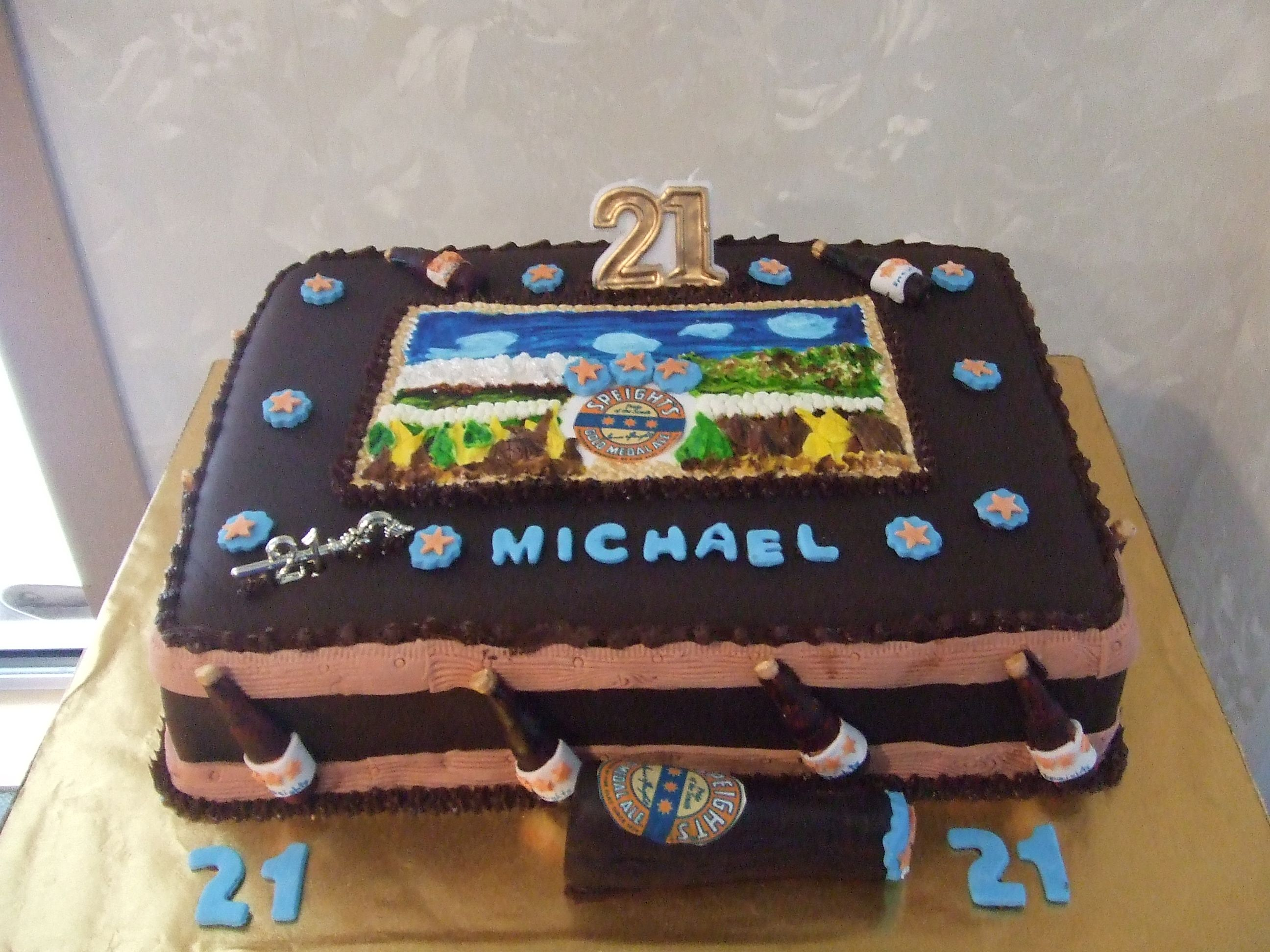 a boys 21st cake theme was a Speights beer bottle and 3 d picture