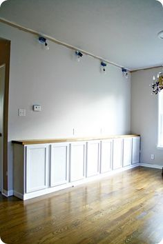 kitchen wall cabinets used as base cabinets for a library built in