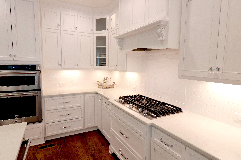 Corner Cabinet White Kitchen Subway Tile Backsplash Herringbone Pattern With Images White Subway Tile Kitchen Custom Home Builders Home Builders