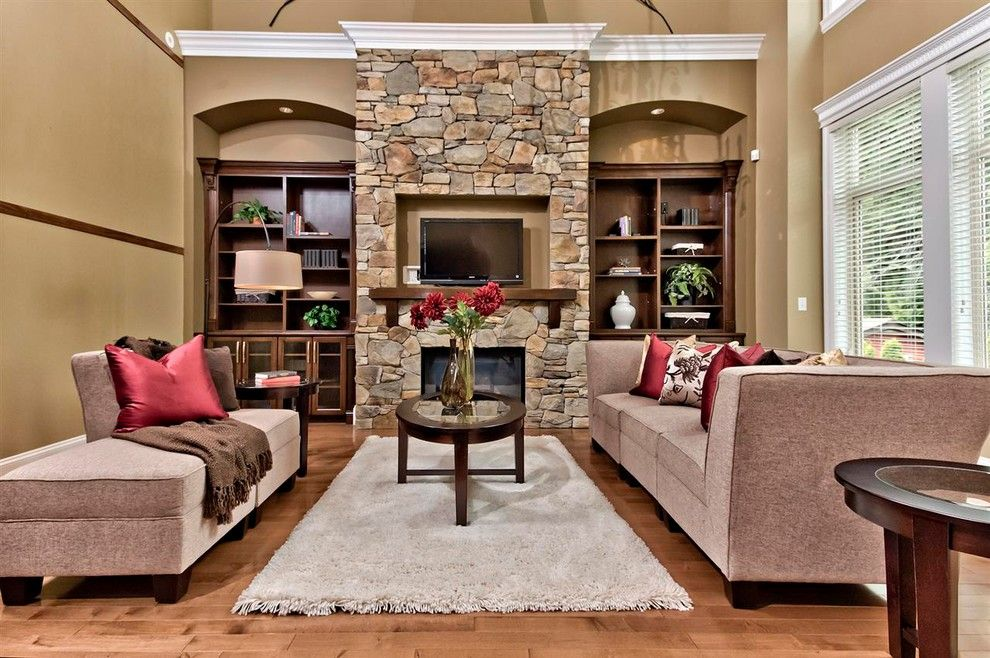 Stone fireplace to ceiling with bookshelves beam