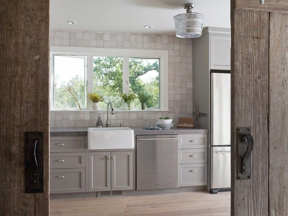 Custom kitchen with concrete countertops, farm sink and