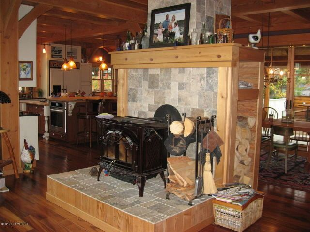 Raised wood stove with wood storage area, enclosed chimeny. Google Image  Result for http - Raised Wood Stove With Wood Storage Area, Enclosed Chimeny. Google