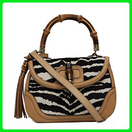 0a5e73b93ba Save on the Gucci Bamboo Top Handle Pony Hair Beige Black Leather Handbag  254884 Satchel! This satchel is a top 10 member favorite on Tradesy.