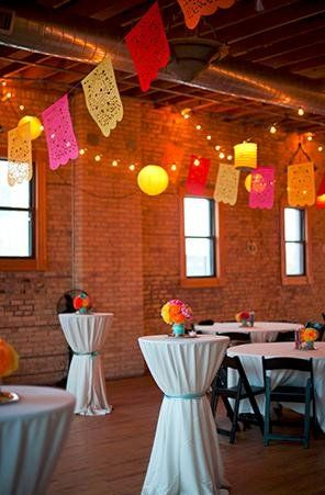 Mexican Papel Picado flags...such a fun ceiling decor option! (Photo by Tiffany Bolk)