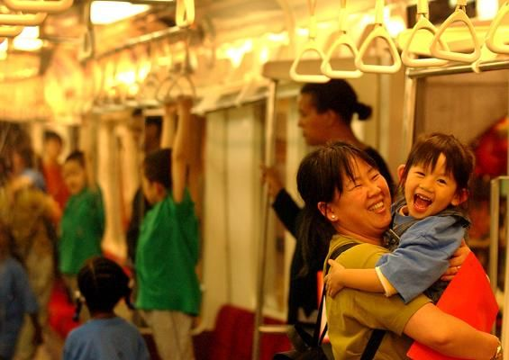 REMOTE TRANSMISSION -- REMOTE TRANSMISSION--- Boston, Ma-- June 5, 2002 Jenny Kwan, of Korea now living in Cambridge, carries her daughter Selena, 9, at the Japanese Metro Station replica at the Childrens Museum as they take part in a Cambridge kindergarten orientation trip for a getting to know you activity. Photo by Essdras M Suarez/Globe photo -- Library Tag 06092002 Education