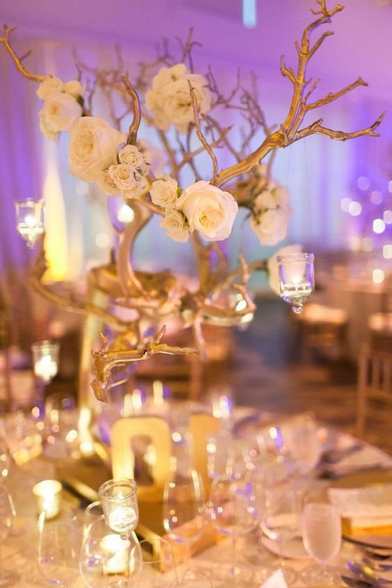 classy white and gold wedding centerpiece via Megan Clouse Photography