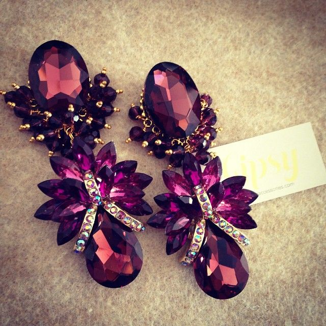 These earrings, deep part, lots of volume for hair, contouring blush, strapless deep purple dress. Lipstick with purple tones. A cuff bracelet. Next wedding.
