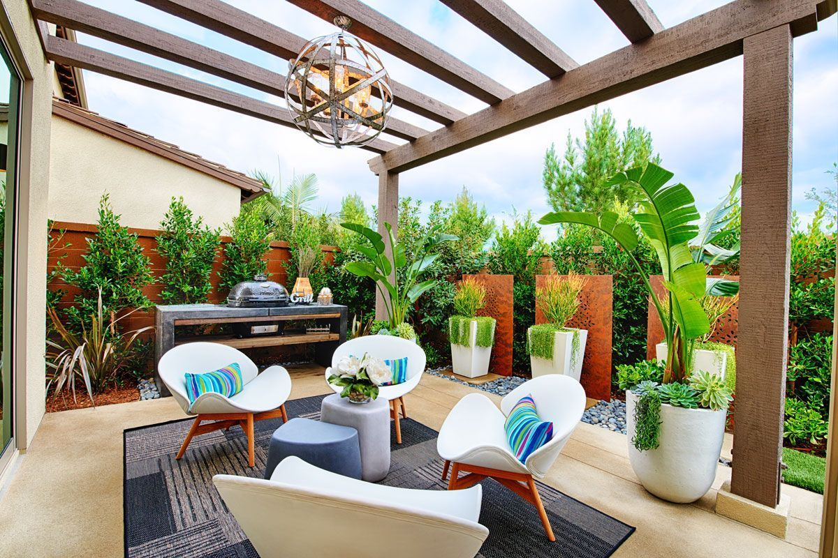 Inviting outdoor space with chandelier, foliage and ... on Attached Outdoor Living Spaces id=45566