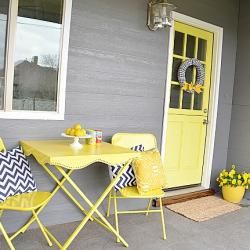 Spray paint and old card table and chairs, add some throw pillows and accessories and voila!