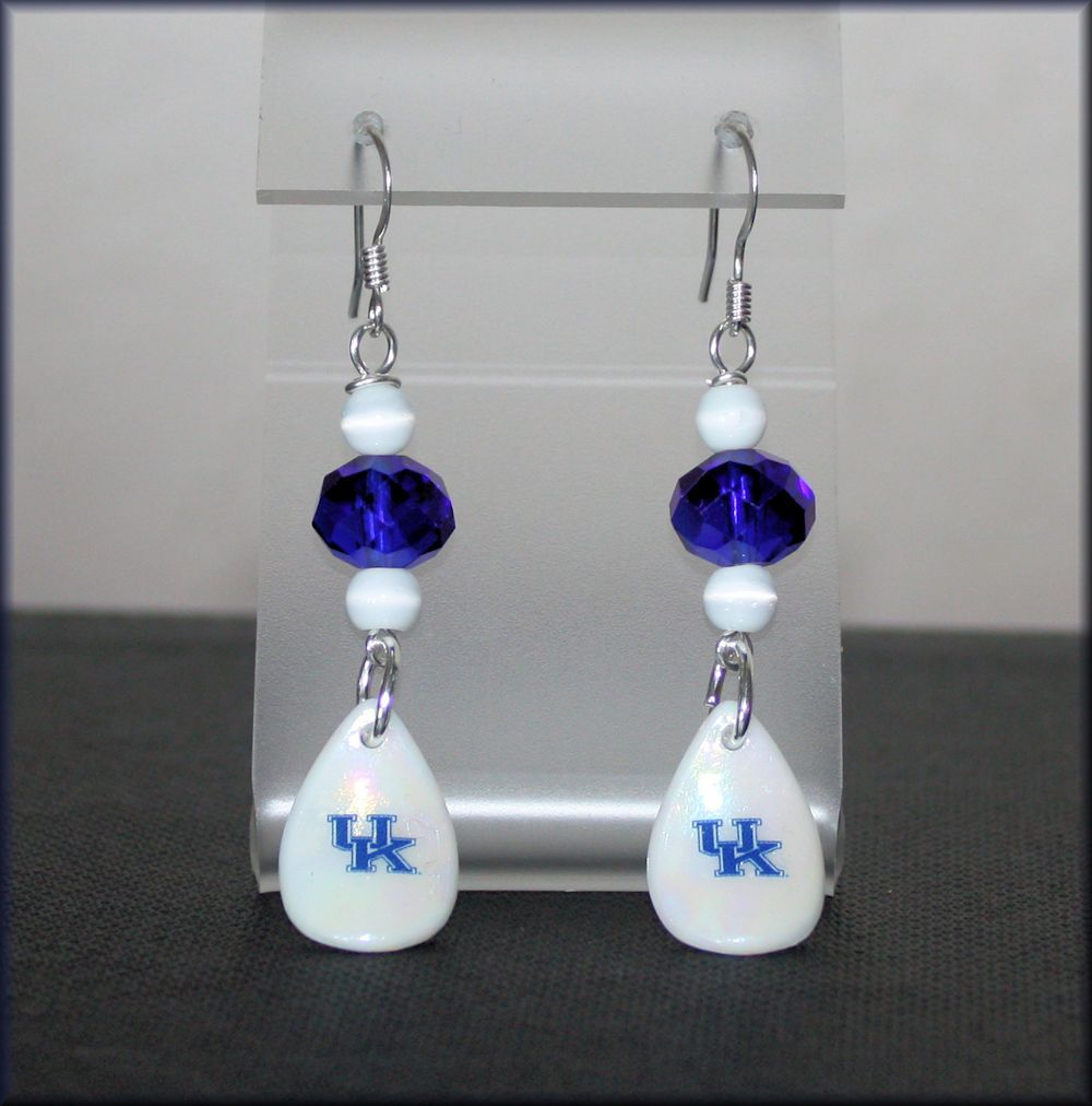 UK is on acrylic with nle glass beads & white cats eye bead ...