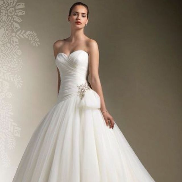 """Justin Alexander - Bridal gown selected """"Gown of the Year"""" by Bridal Buyer and fans!  Available at Bridal Elegance!!"""