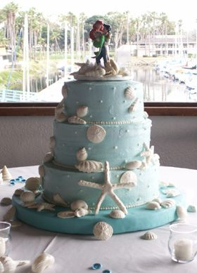 This Three Tiered Beach Inspired Wedding Cake Is Topped Off With Price Eric And Ariel From Disney S The Little Mermaid White Chocolate Starfish