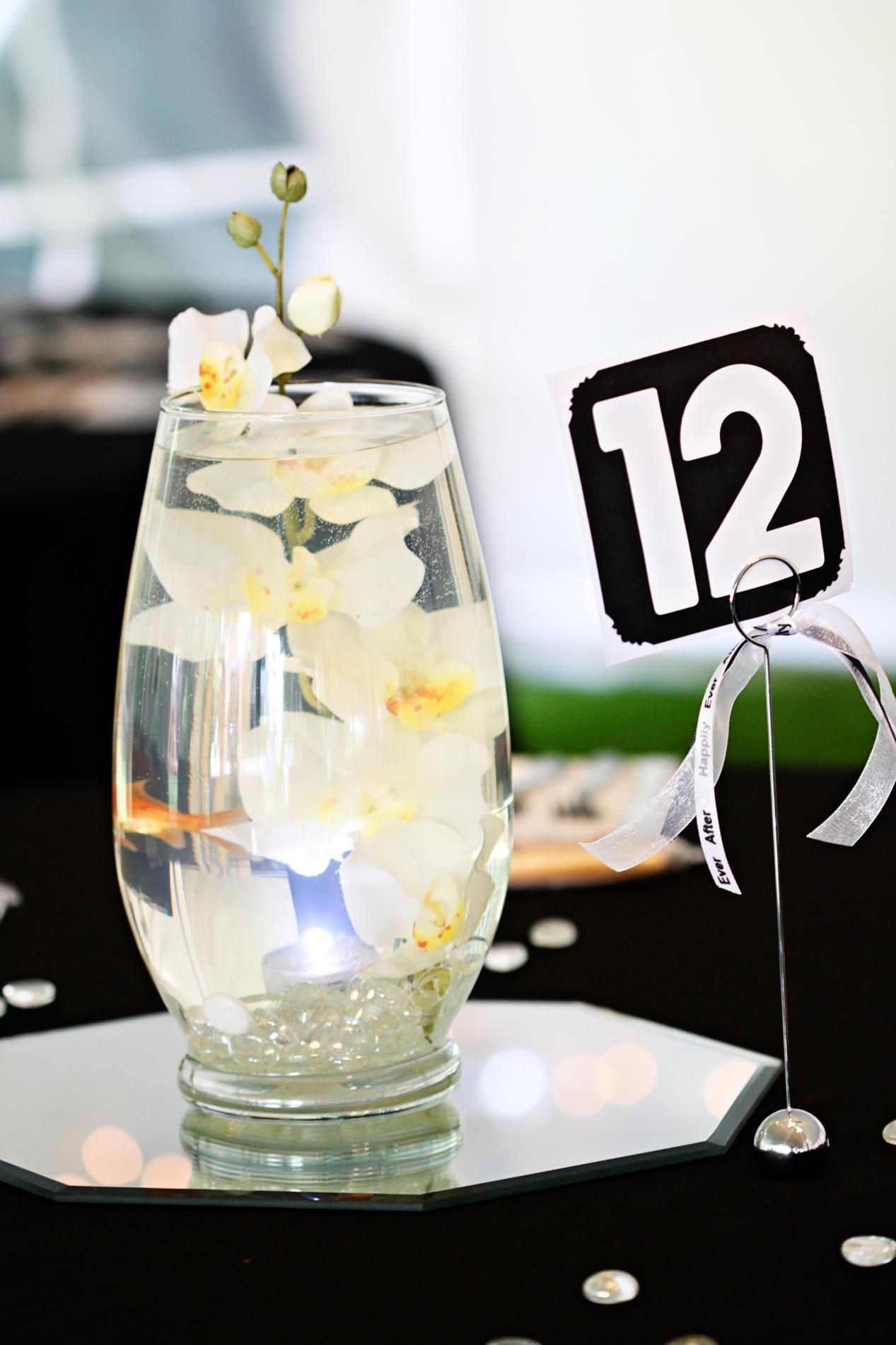 Goldfish in the centerpieces add dimension and movement for a unique ...