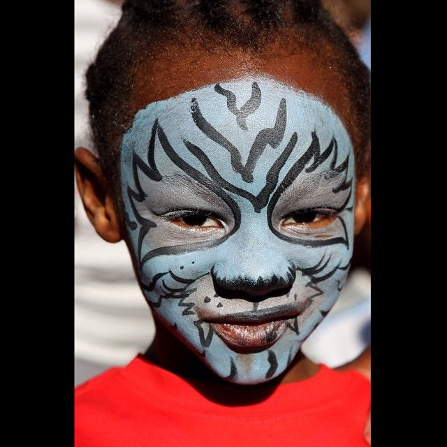 Andre Riddle, 4, poses with his fresh face paint at the Taste of Cincinnati Saturday, May 23, 2015. The Enquirer/Meg Vogel.