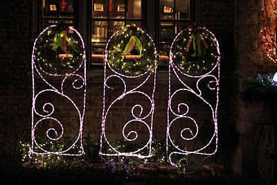 Summer flower trellises decorated with candy cane rope light and summer flower trellises decorated with candy cane rope light and christmas wreathes perfect for christmas mozeypictures Gallery