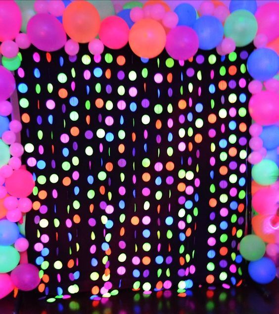 The Photo Backdrop For The Neon Glow Party Was So Cool I Really Enjoyed Seeing All The Kids And Adults Glow Birthday Party Neon Party Neon Party Decorations