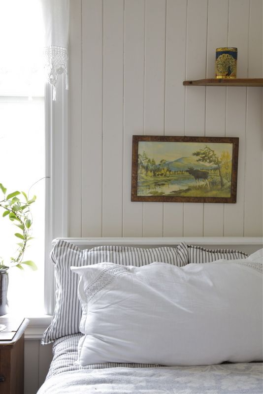 clean modern cabin decor - love the small painting + ticking fabric against all that white