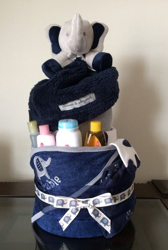 Let your baby sail the ocean blue! Includes: Soft plush navy blue anchor/sailboat theme blanket, 12 nautical themed washcloths, Carter's Little Mate button onesie short set size 3 months, 2 bibs, a pa