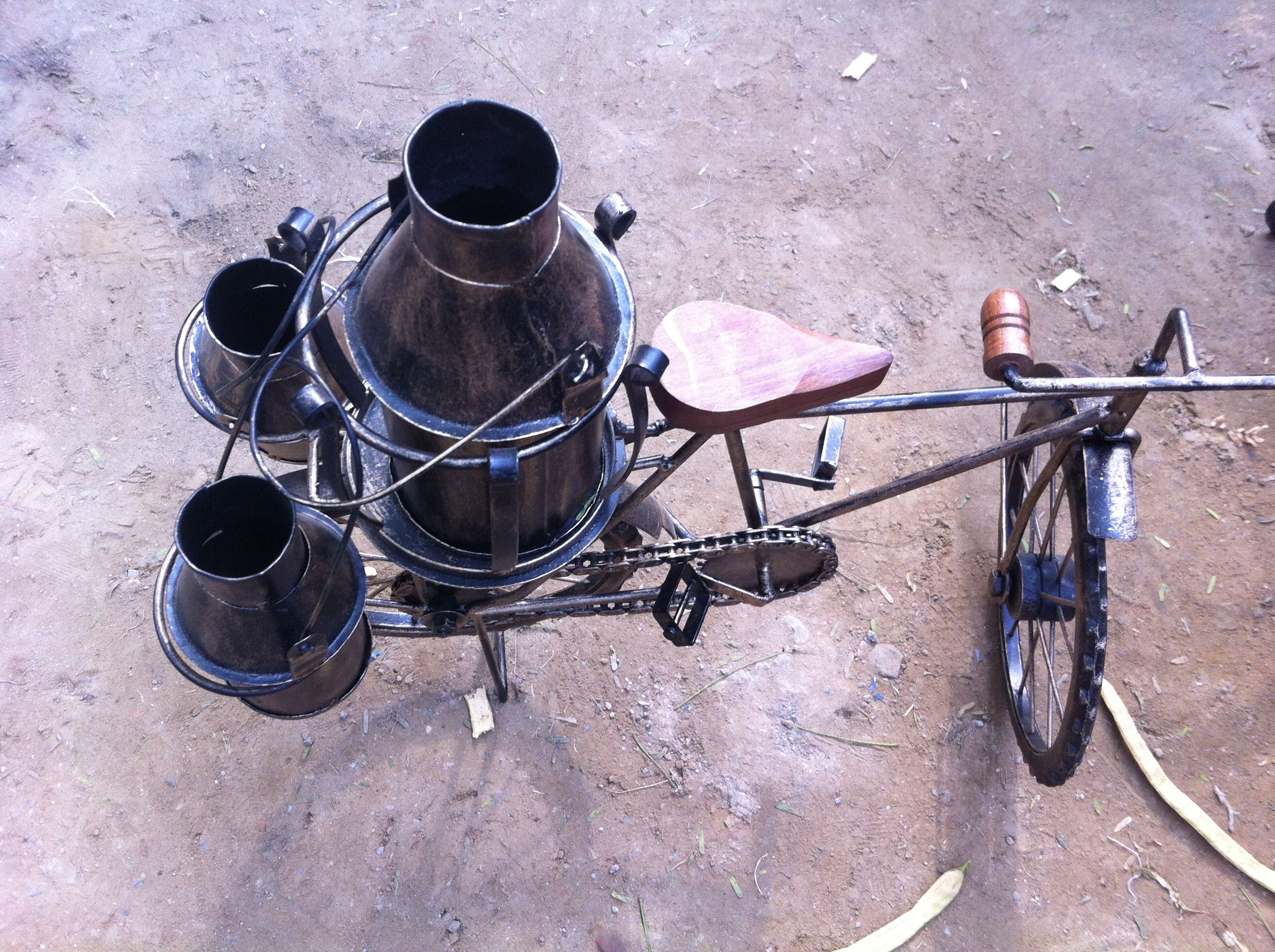 The Indian Milkman - Still seen in the Indian towns and villages, the milk man delivers fresh milk from door to door on his bicycle and cans of milk. Hand crafted from wrought iron and wood.   shop this at : www.theindianweave.com