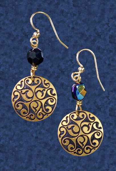 """Celtic Swirl Earrings - Dramatic swirls and spirals, inspired by art from the La Tene period of Celtic history. This timeless and elegant design is sure to become a favorite. These earrings are handmade in the USA from German silver, copper, bronze and Czech glass, with surgical steel ear wires. Earrings are 5/8"""" in diameter."""