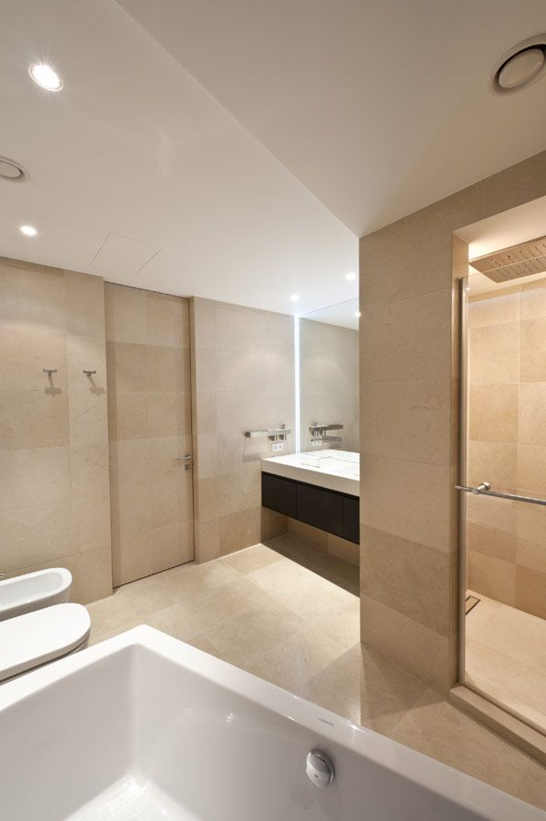 Bathroom in soft yellow-brown limestone. Apartment in Moscow by Russian interior-designer Allexandra Fedorova.