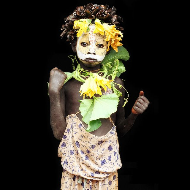 little surma girl well decorated with fruits an flowers from ethiopia by abgefahren2004, via Flickr