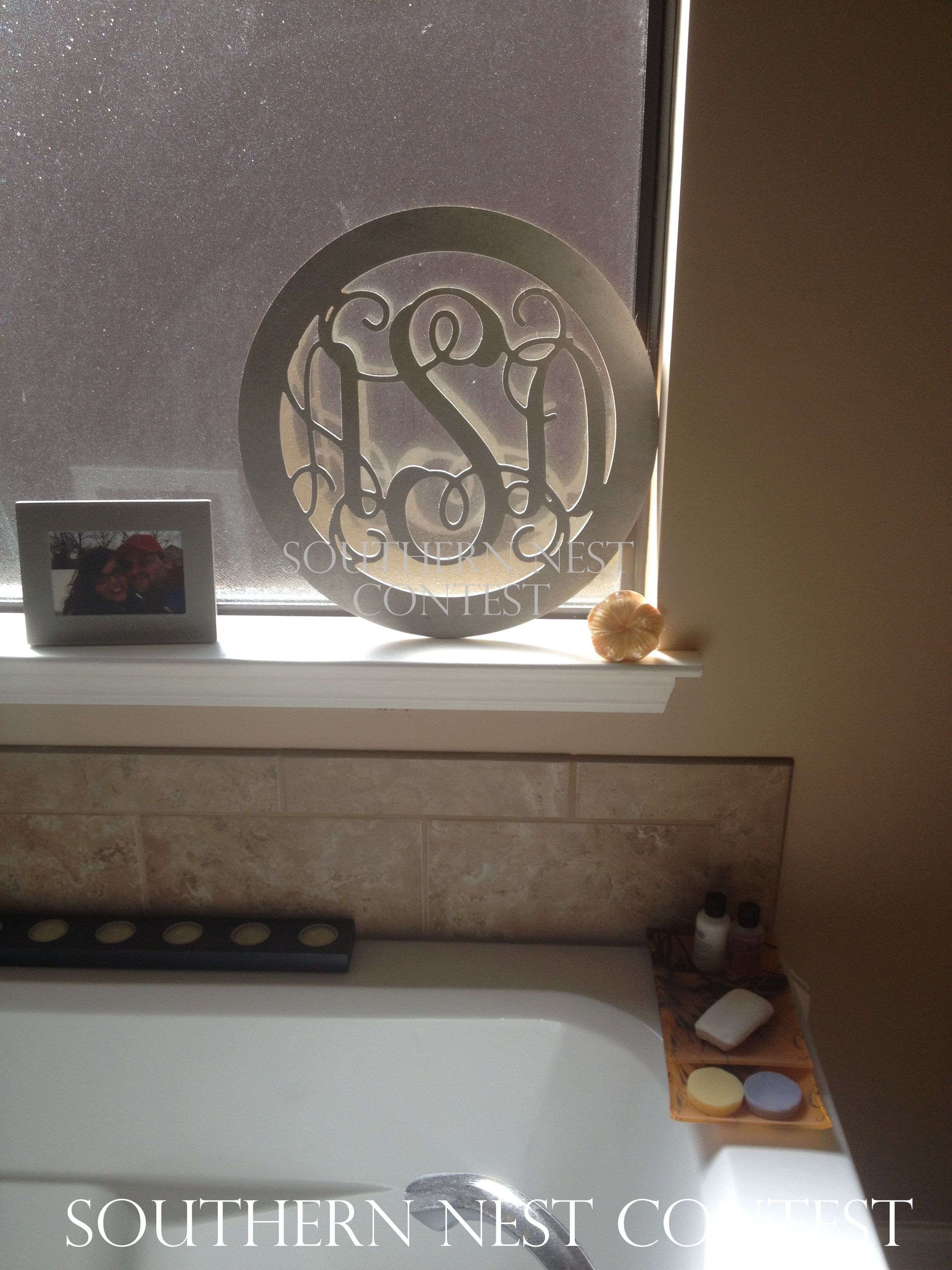 """I placed my large (18"") wooden circle monogram on the ledge of my window above my bathtub. I pained it silver to match my bathroom colors. It looks so pretty when the light shines in!"" -Abby"