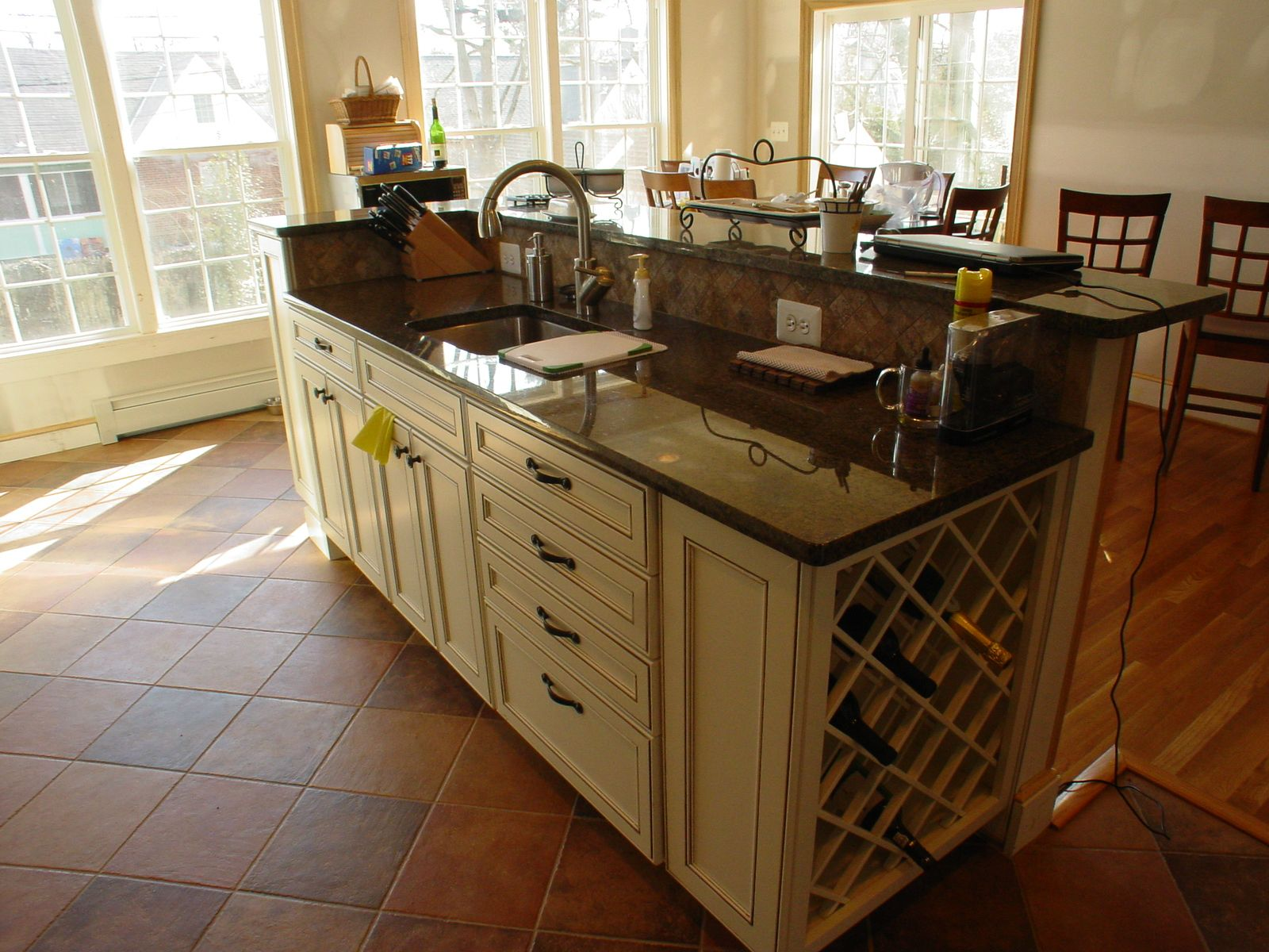 kitchen island with prep sink wone rack and eating area
