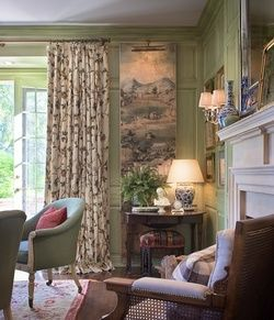 gracious living room with french doors opening up to a sunny garden all done up