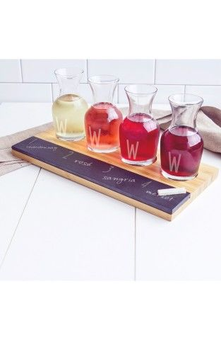Cathy's Concepts Personalized Wine Tasting Flight. Four miniature glass wine carafes personalized with an etched initial are matched with a bamboo-wood flight board featuring a slate front panel for easy labeling of each wine
