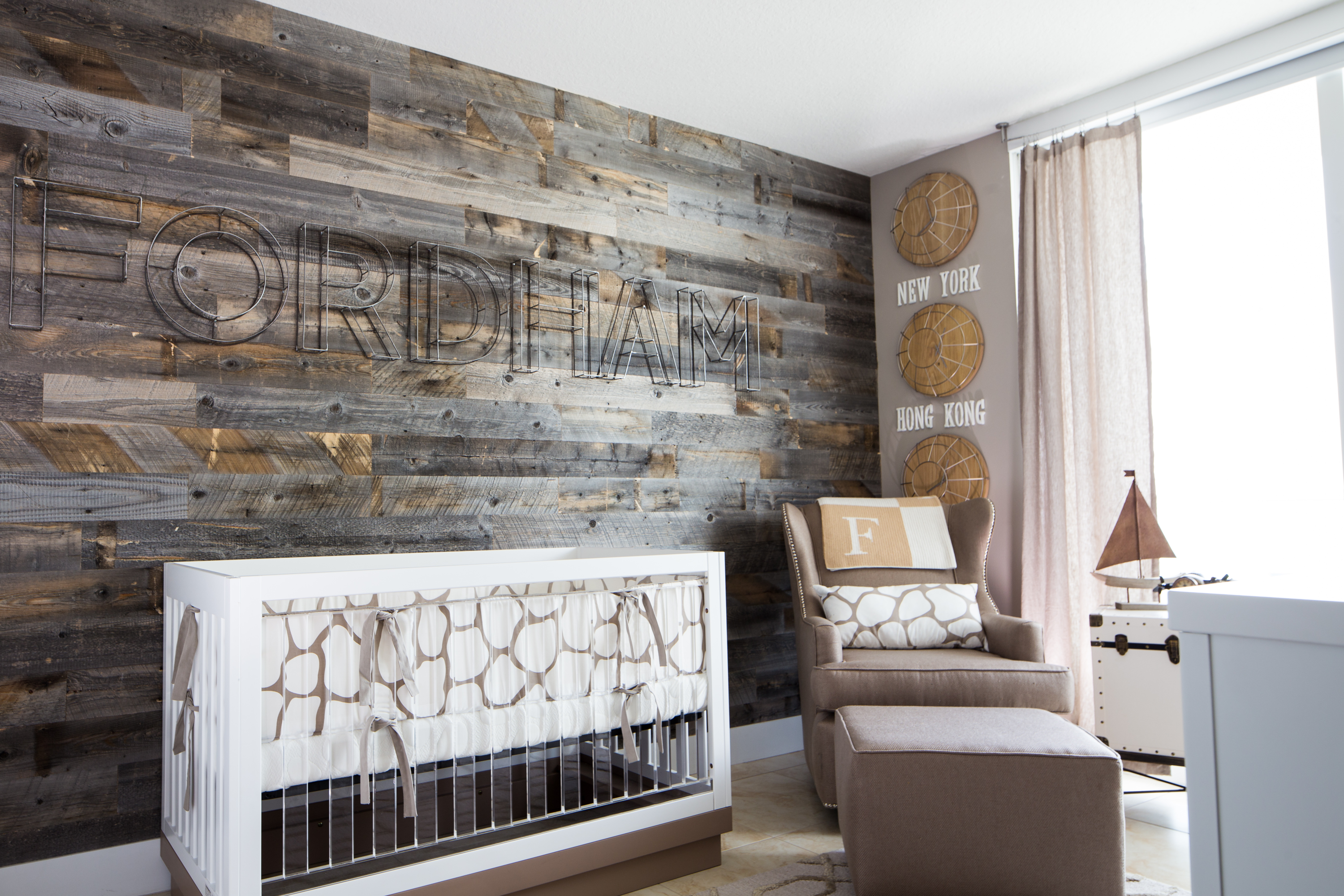 We love a wood accent wall in a baby boy's nursery - and these peel and stick wall planks from @Stikwood make it an easier task!