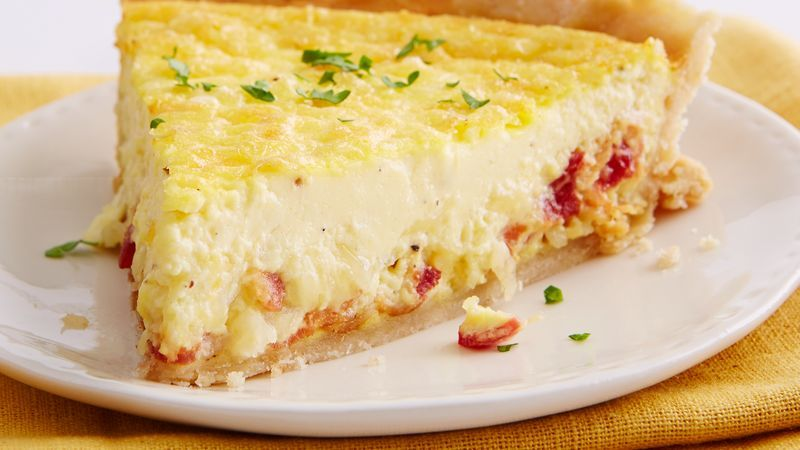 Quiche Lorraine has a savory custard and is usually flavored with bacon and Swiss or Gruyere cheese. Our version of Quiche Lorraine is just that: made with a creamy, cheesy, savory center and baked on a flaky, warm crust for a brunch recipe that's filling.