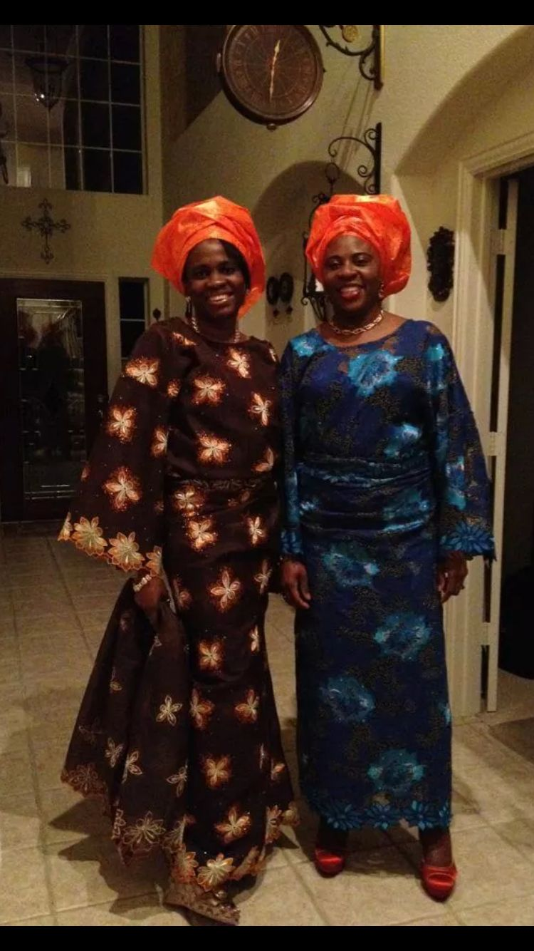 Preparing For A 50th Birthday Party Dresses Up In Nigerian Iro And Buba With Orange Gele