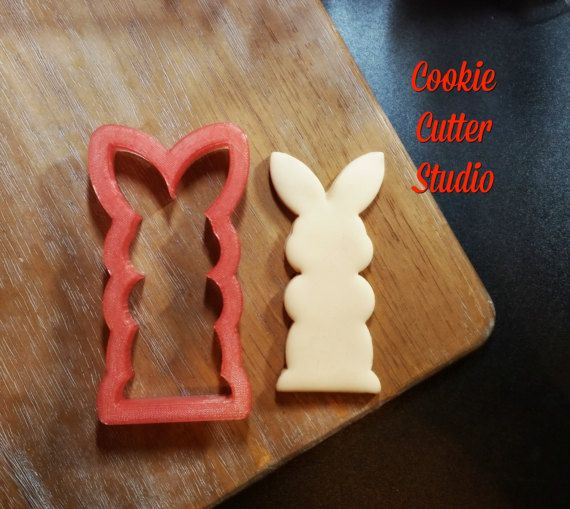 This cute little boy bunny cutter is available in two sizes. Check out our other listing for her cute little friends. Available in 3 1/2 and 4 1/2 inches tall.  All sizes are approximate. These cutters can be purchased in a set or individually. Cutters are printed as they are ordered. Our cutters are designed with a sturdy handle for ease when handling and a tapered cutting edge to give a clean cut. Cookie Cutter Studio cutters are made of filament approved by the FDA for food conta...