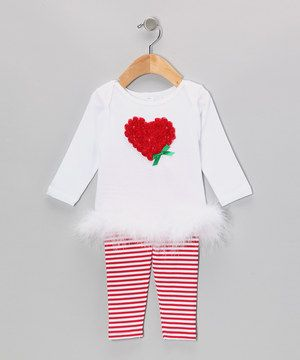 Marvelous marabou feathers raise this set to a whole new level of merry cheer. With a rosette-covered heart on the top, handy lap neck and an elastic waistband, fitting into the ensemble is a full-on treat.