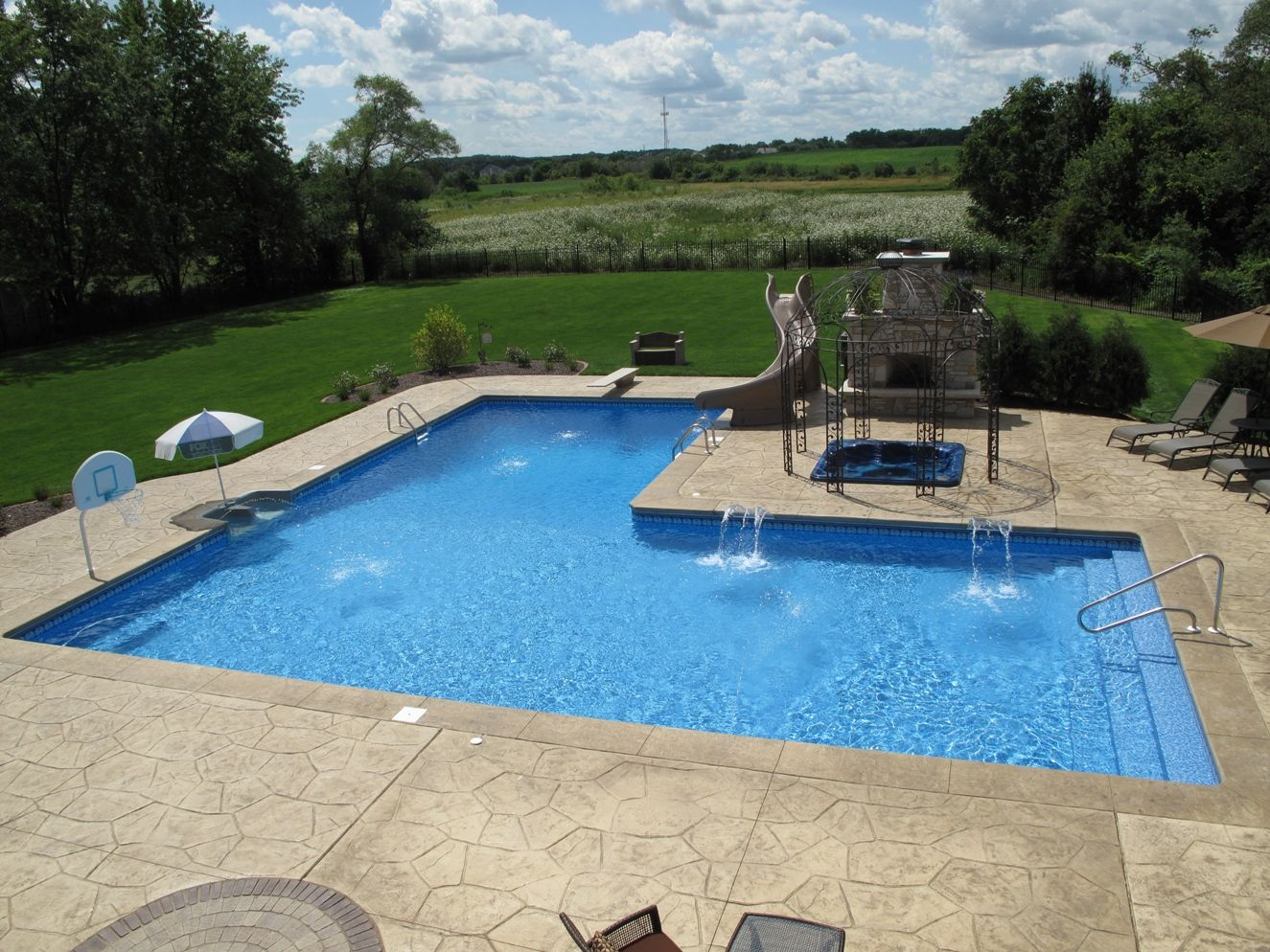 Custom l shaped pool designed by aqua pools and built in for Custom inground swimming pools