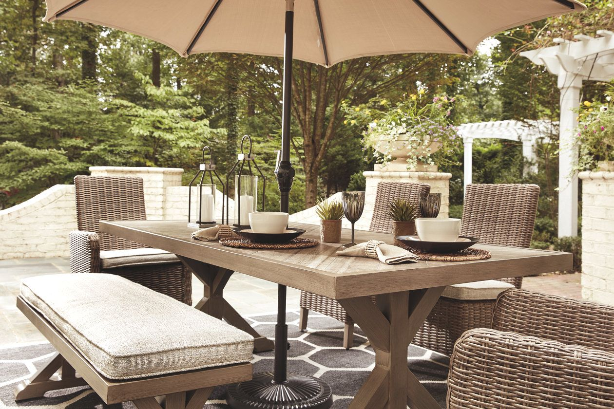 Beachcroft Dining Table With Umbrella Option Ashley Furniture Homestore Outdoor Dining Table Outdoor Dining Set Outdoor Dining