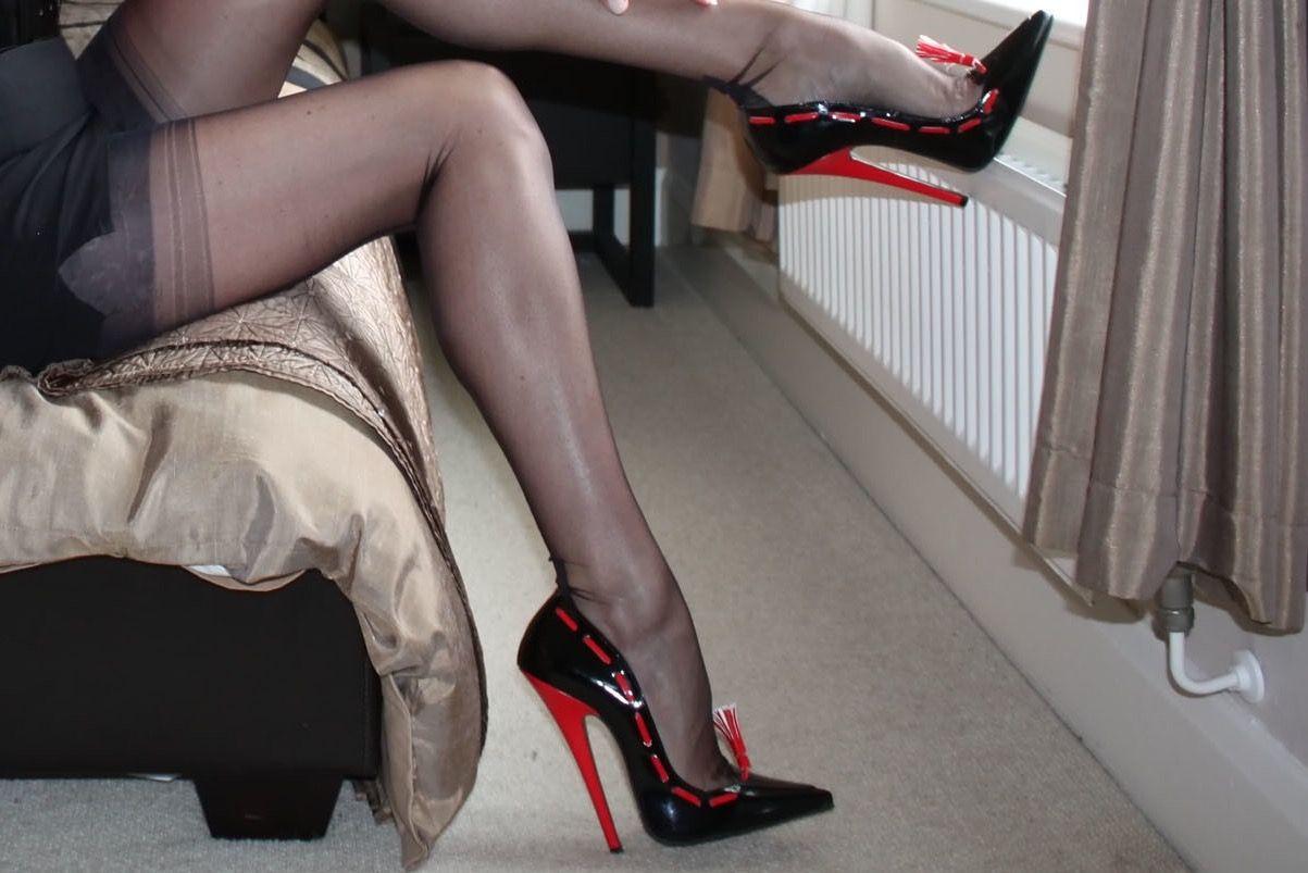 Ankle strap shaved bound fishnet hose stiletto heels