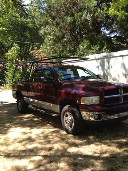 """The Dodge.... 2003 2500 heavy duty (and high output) 4x4 MANUAL 6spd. Cummins 5.9 turbo diesel (of course) Laramie xlt. Jeeze! what a mouthful! I guess I could just say, """"this truck has every desirable option a person who knows trucks would want to have on a truck"""".... It is totally stock, and it is going to stay that way!.... Because as soon as you start 'tuning' and 'tweaking' things, you also start breaking things. Expensive things!.....  No, this truck is awesome just the way it…"""
