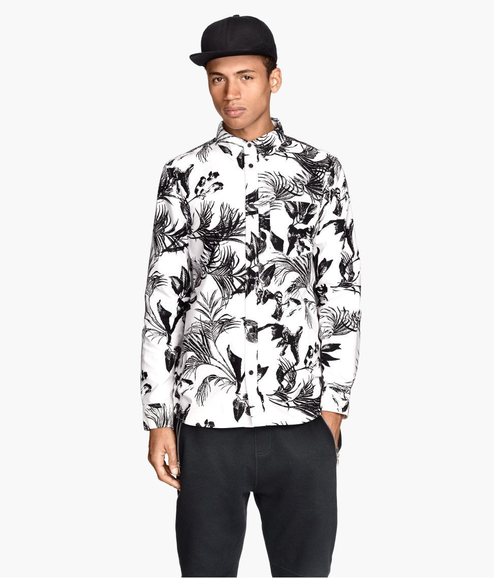 Black & white long-sleeve shirt with tropical leaf print & chest ...