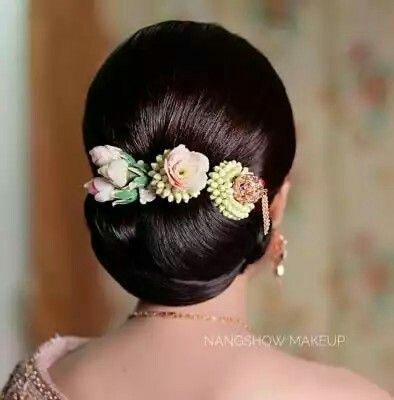 Lower Bun With Floral Decoration Mostly Suits On Saree Or Long Gown Bridal Hair Buns Bun Hairstyles Bridal Hair