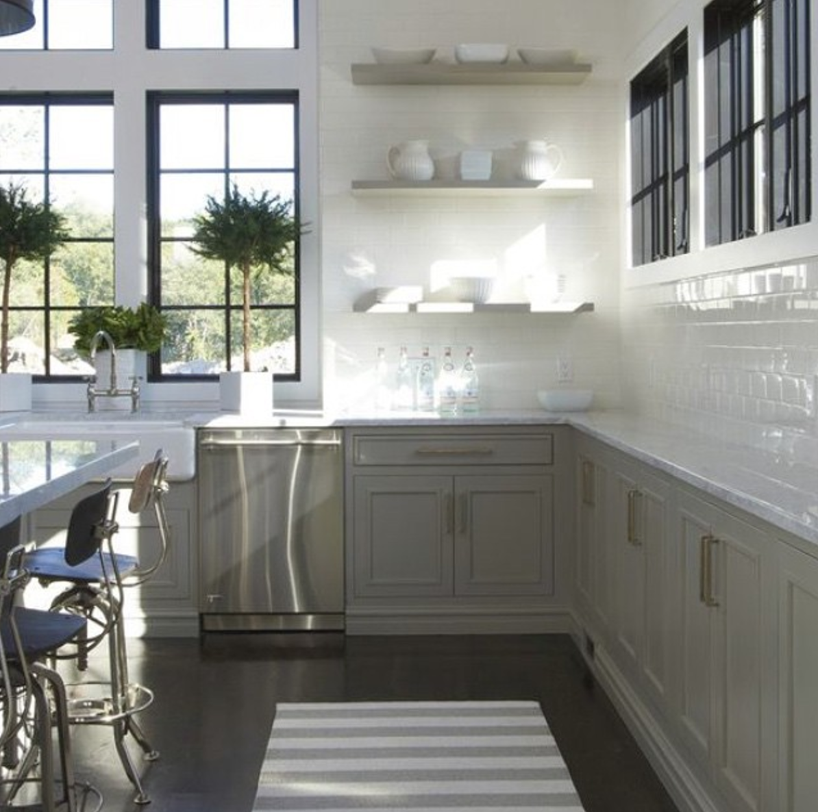 Grey and white contemporary kitchen with no upper cabinets double