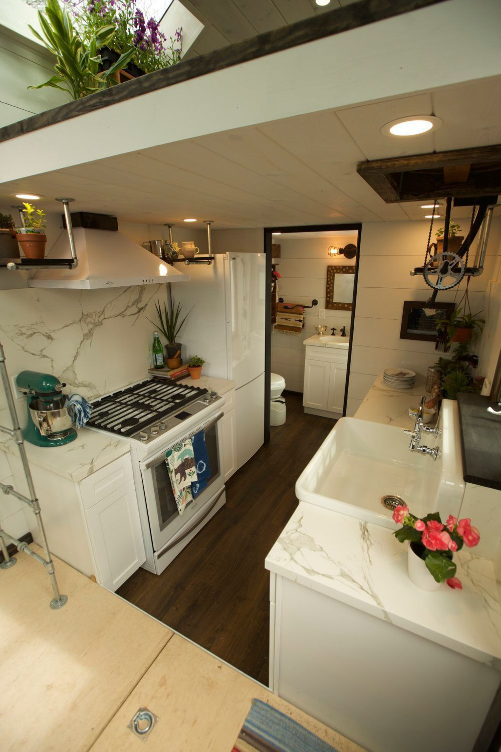 The galley kitchen includes a five burner gas range, farmhouse sink ...