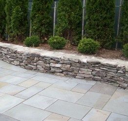 Love The Mix Of Texture   Rough Finish With Formal Ashlar Pattern. Bluestone  Patio With Natural Stone Wall.